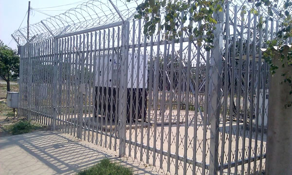 Palisade Fence with Razor Wire